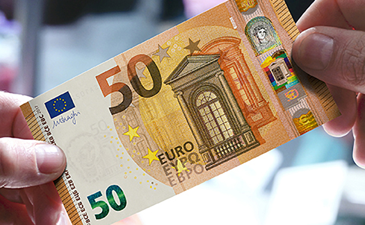 Two hands holding the new €50