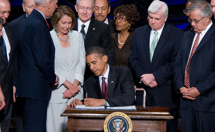 President Obama signs the Dodd-Frank Act