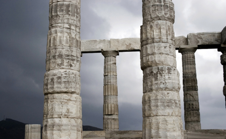 temple-of-poseidon-ruins-stone-columns-against-cloudy-sky