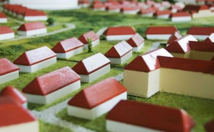 toy-model-village-red-and-white-houses-on-green
