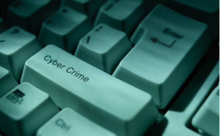Cyber crime key on keyboard